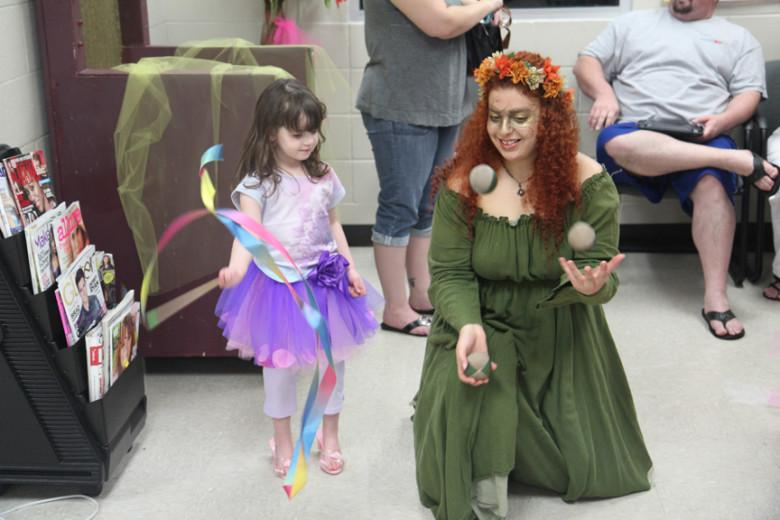 Senior 'juggles' festivals, flowers, princesses
