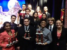 Lots of hardware: the team standing with their winnings. Photo courtesy of Cy Creek Speech and Debate