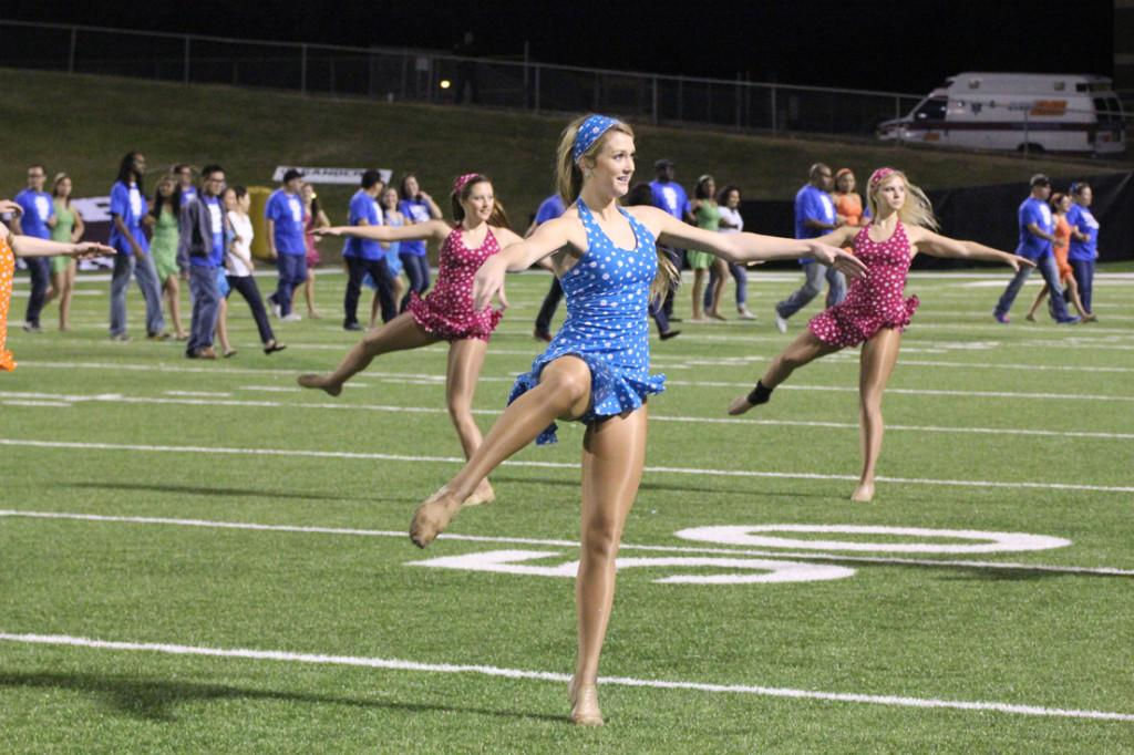On+the+football+field%3A++Senior+Laynie+Hardisty+prepares+for+a+turn.+She+will+be+dansing+at+the+show-offs+in+the+officer%27s+dance