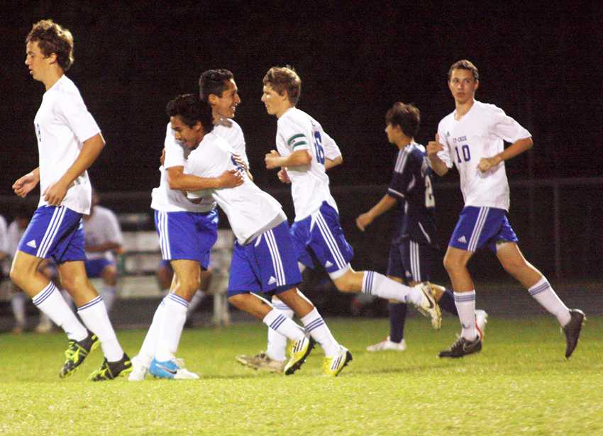 Victory dance:  Junior Jose Molina hugs junior Bryan Arriola as he celebrates scoring the third goal in last game against Cy Ranch, securing victory. The team hadn't won any district games beforehand. Photo by Dairyn Salguero