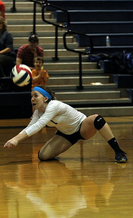 Senior varsity volleyball player Payton Brown dives for the ball during the Cy Ranch game. Creek won the game.