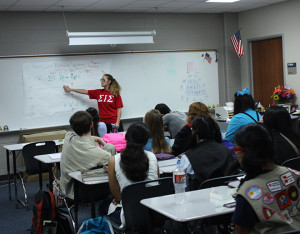Leading the class: Government teacher Nicole Cuellar explains to her fourth period government AP class an assignment involving the various parts of the political spectrum.