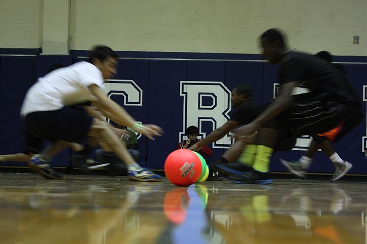 Competitors rush to pick up dodgeballs.