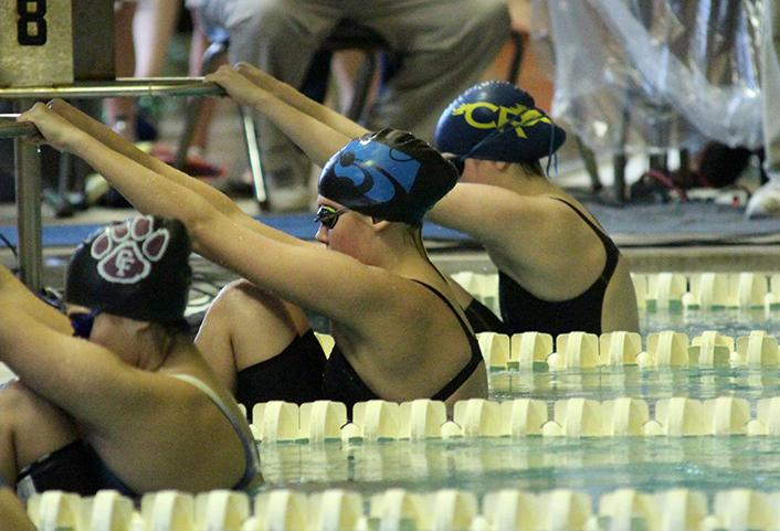 Freshman Alyssa Khol before swimming her event.