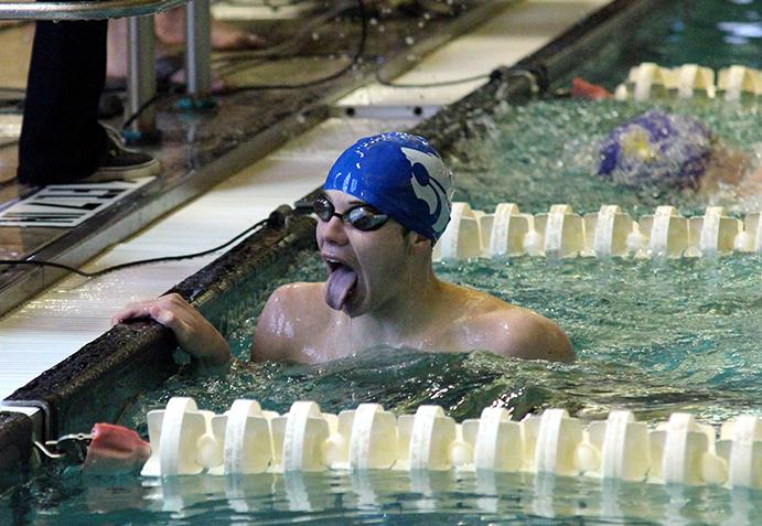 Junior Braxton Flowers after winning first in the 100m backstroke.