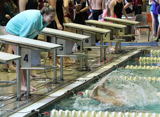 Senior Annie Eubanks cheers on Senior Nikki O'Donnell in the 200m freestyle.