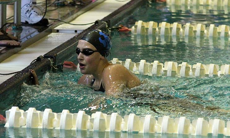 Senior Tori Karker finishes the 200m freestyle. She placed first in the event.