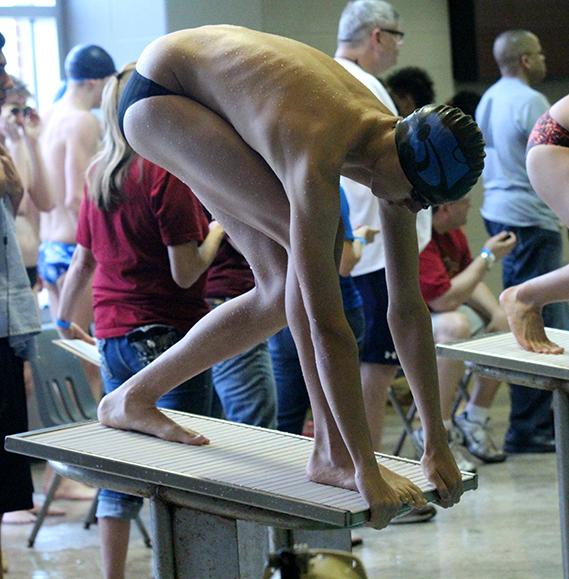Sophomore Parker Knight before swimming his event.