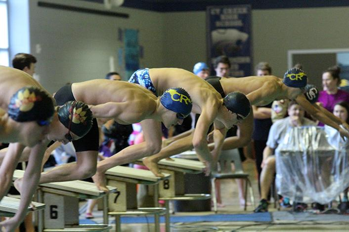 Sophomore Todd Coachman dives off the block to swim the 200m freestyle. He placed fourth overall in the event.