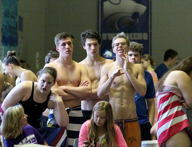 Junior Braxton Flowers and Seniors Sam Shorr, Damian Wilkerson and Chance Morris cheer on their teammates.