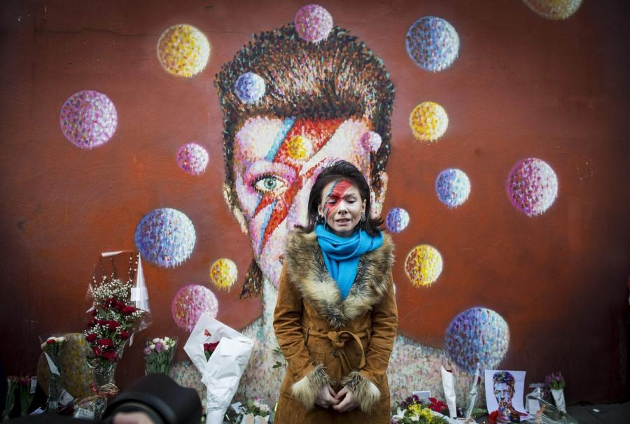A fan visits the mural of David Bowie in Brixton where the star grew up, to pay her respects, on Jan. 11, 2016 in London. (Ben Stevens/i-Images/Zuma Press/TNS)