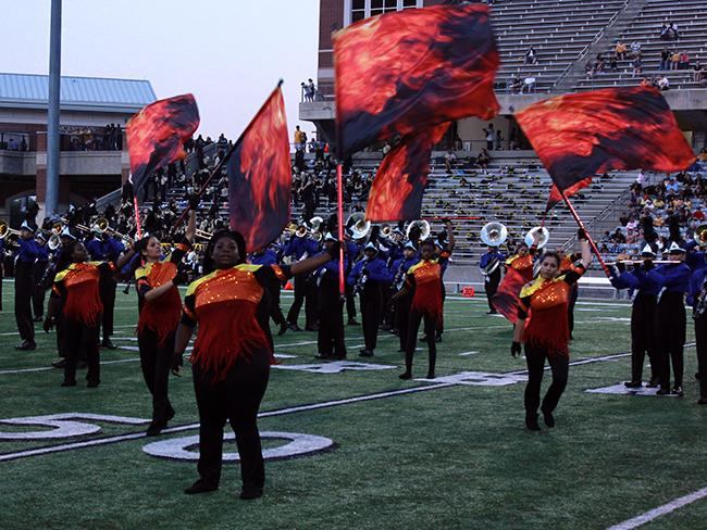 Color guard performs during the halftime show.