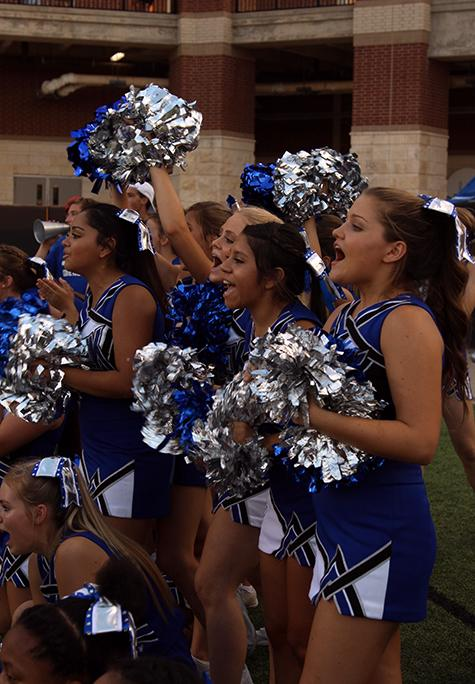 Cheerleaders yell in support of the boys in blue.