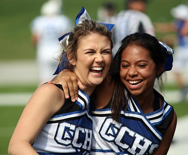 Cheerleaders celebrate during the final football game of the season.