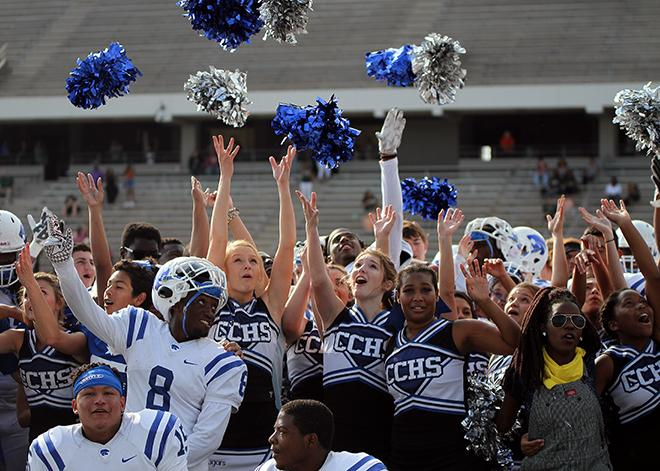 Cheerleaders, football players and Silvies celebrate a final victory for the season.