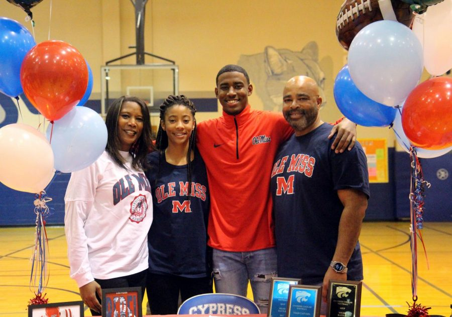 Miles Battle poses with family