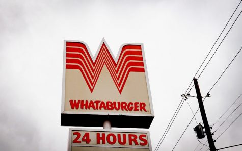 A sign for a Whataburger fast food restaurant in Nacogdoches, Texas.