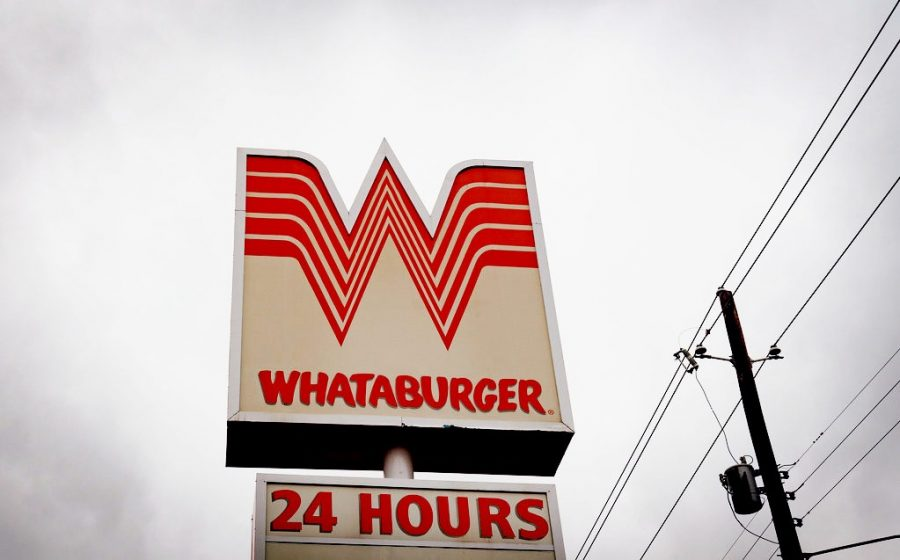 A+sign+for+a+Whataburger+fast+food+restaurant+in+Nacogdoches%2C+Texas.