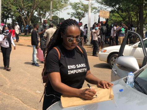 """File:Female End SARS protester in Abuja, Nigeria Oct 12, 2020 01-22-03 pm.jpeg"" by Aliyu Dahiru Aliyu is licensed under CC BY-SA 4.0"